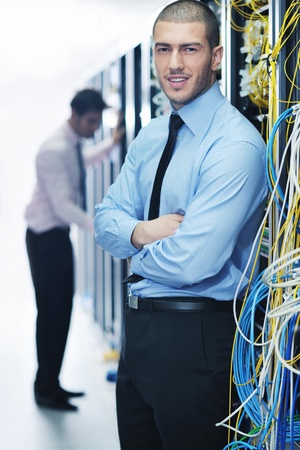 server technology: group of young business people it engineer in network server room solving problems and give help and support