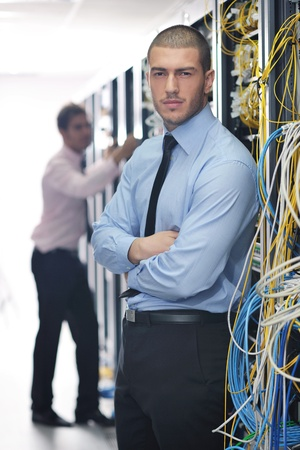 group of young business people it engineer in network server room solving problems and give help and support Stock Photo - 11023174