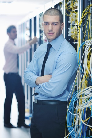 group of young business people it engineer in network server room solving problems and give help and support Stock Photo - 11023270