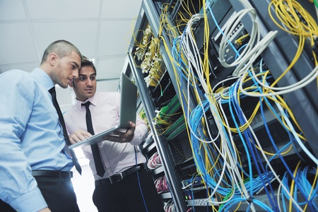 network server: group of young business people it engineer in network server room solving problems and give help and support