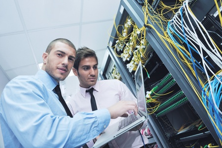 group of young business people it engineer in network server room solving problems and give help and support Stock Photo - 11023361