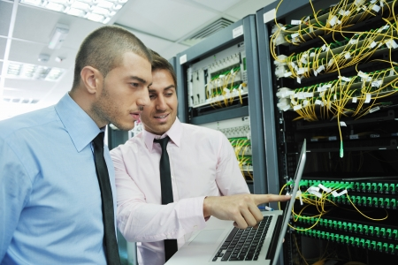 virtual server: group of young business people it engineer in network server room solving problems and give help and support