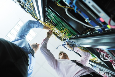 network engineer: group of young business people it engineer in network server room solving problems and give help and support