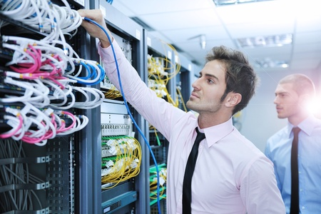 group of young business people it engineer in network server room solving problems and give help and support Stock Photo - 11023271