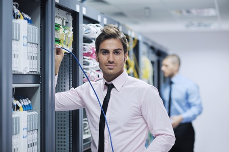 group of young business people it engineer in network server room solving problems and give help and support Stock Photo - 11023178
