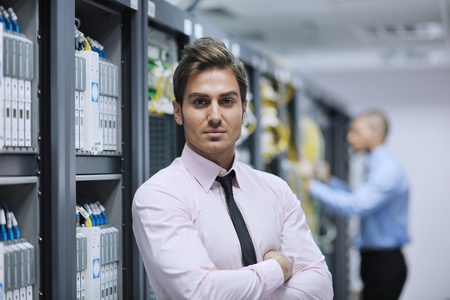 server rack: group of young business people it engineer in network server room solving problems and give help and support
