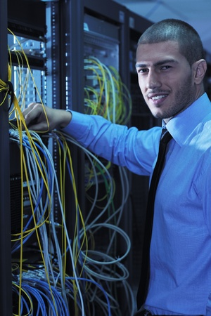 young handsome business man  engeneer in datacenter server room Stock Photo - 11023431