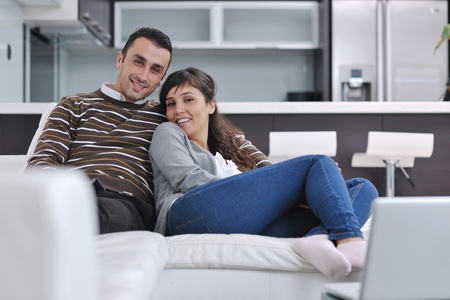 comfort room: happy young couple relax at modern home living room indoor