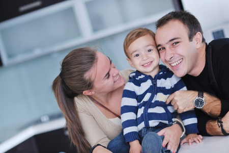 happy young family have fun and relaxing at new home with bright furniture Stock Photo - 11133049