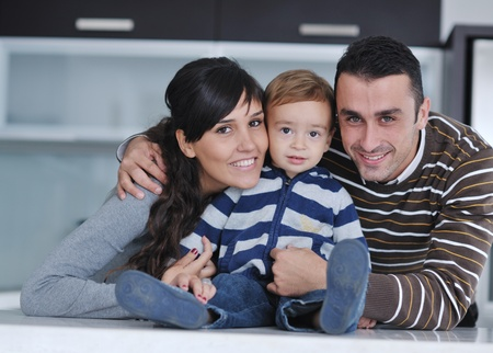 happy young family have fun and relaxing at new home with bright furniture Stock Photo - 11133036