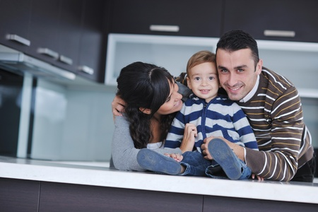 happy young family have fun and relaxing at new home with bright furniture Stock Photo - 11132960