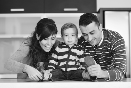 happy young family have fun and relaxing at new home with bright furniture Stock Photo - 11133031