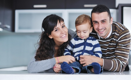 happy young family have fun and relaxing at new home with bright furniture Stock Photo - 11133043