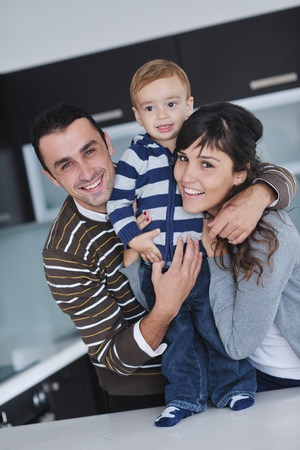 young family: happy young family have fun and relaxing at new home with bright furniture