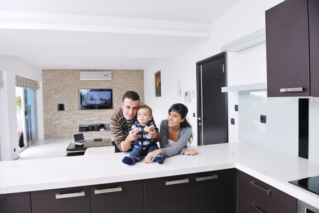 family sofa: happy young family have fun and relaxing at new home with bright furniture
