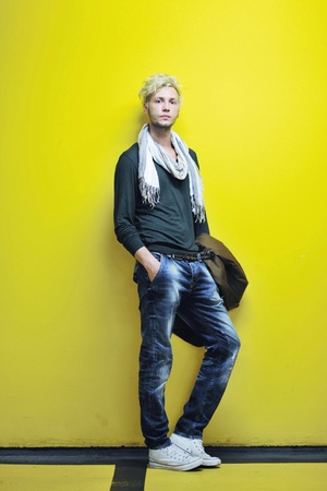 Portrait of an handsome young  man  with urban background and fashion clothes style Stock Photo - 11132869