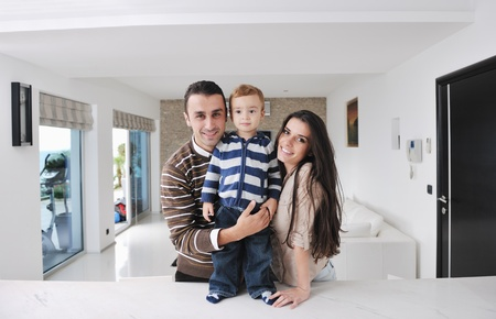 happy young family have fun and relaxing at new home with bright furniture Stock Photo - 11422671