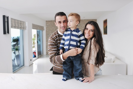 happy young family have fun and relaxing at new home with bright furniture Stock Photo - 11422669