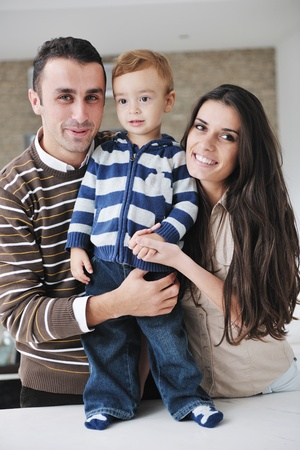 happy young family have fun and relaxing at new home with bright furniture Stock Photo - 11422672
