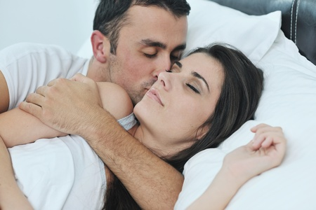 happy young healthy people  couple have good time in their bedroom make love and sleep Stock Photo - 11196446