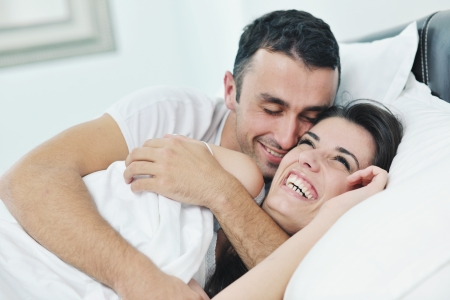 happy young healthy people  couple have good time in their bedroom make love and sleep Stock Photo - 16390505