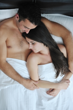 happy young healthy people  couple have good time in their bedroom make love and sleep Stock Photo - 16390434