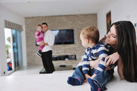 happy young family have fun and relaxing at new home with bright furniture Stock Photo - 11279163