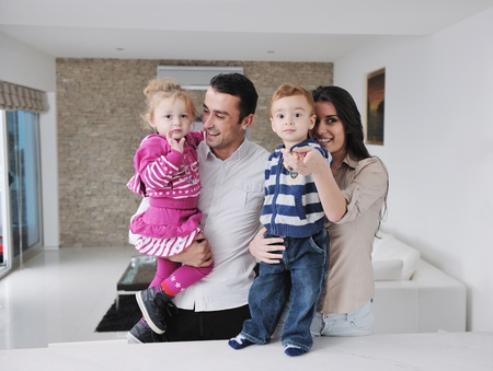 happy young family have fun and relaxing at new home with bright furniture Stock Photo - 11422682
