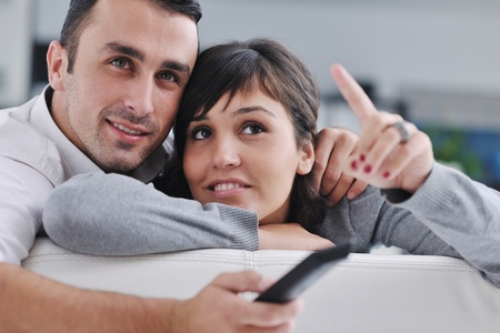 Relaxed young  couple watching tv at home in bright living room Stock Photo - 11279169