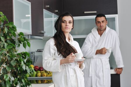 Young love couple taking fresh morning cup of coffee in the modern appartment Stock Photo - 11317319