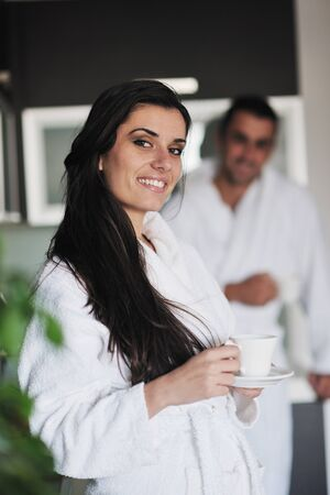 Young love couple taking fresh morning cup of coffee in the modern appartment Stock Photo - 11317315