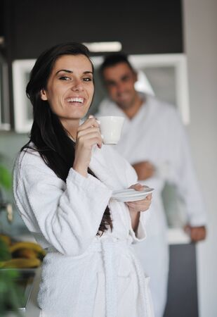 Young love couple taking fresh morning cup of coffee in the modern appartment Stock Photo - 11291571
