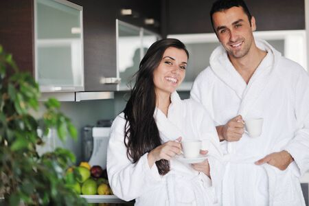 Young love couple taking fresh morning cup of coffee in the modern appartment Stock Photo - 11291570
