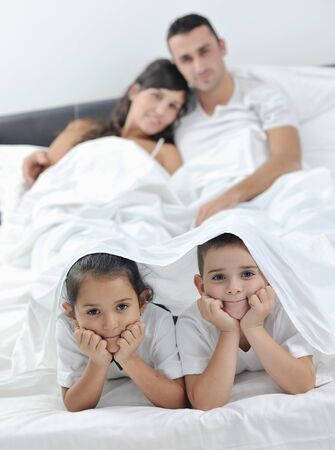 happy young Family in their bedroom have fun and play in bed Stock Photo - 11292843