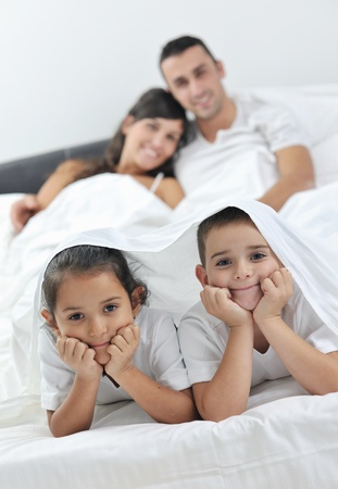 happy young Family in their bedroom have fun and play in bed Stock Photo - 11292904