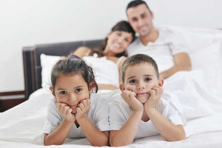 happy young Family in their bedroom have fun and play in bed Stock Photo - 11292931