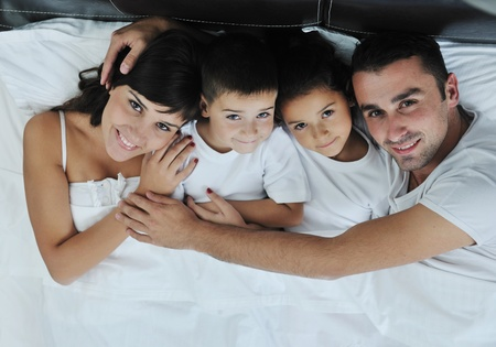 happy young Family in their bedroom have fun and play in bed Stock Photo - 11274728