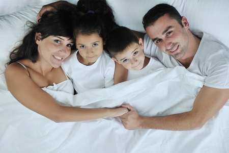 happy young Family in their bedroom have fun and play in bed Stock Photo - 11274732