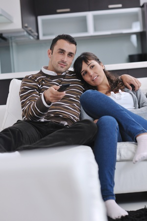 Relaxed young  couple watching tv at home in bright living room Stock Photo - 11274729