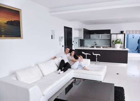 happy young couple relax at modern home living room indoor Stock Photo - 11422697
