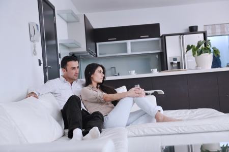 family  room: happy young couple relax at modern home living room indoor