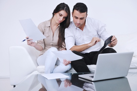 joyful couple relax and work on laptop computer at modern living room indoor home Stock Photo - 11293222