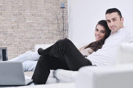 modern life: happy young couple relax at modern home living room indoor