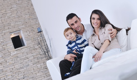 happy young family have fun and relaxing at new home with bright furniture Stock Photo - 11410859