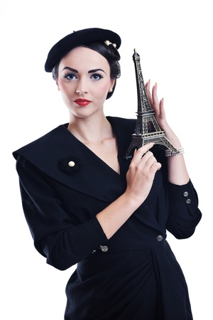 beautiful young woman hold paris symbol eiffel tower isolated on white background and representing travel and tourist concept photo