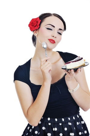 beautiful young retro pinup  woman eat sweet cake food isolated on white iin studio, representing diet and healthy concept photo