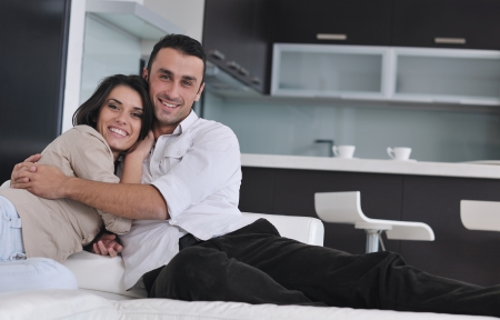 happy young couple relax at modern home living room indoor Stock Photo - 16393113
