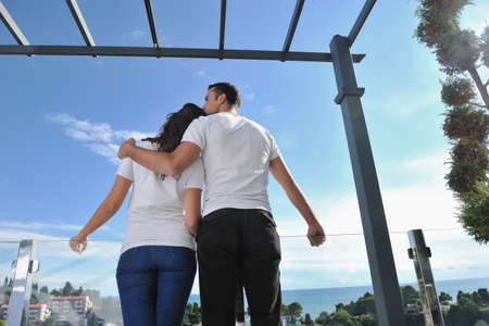 happy young couple relax on balcony outdoor with ocean and blue sky in background Stock Photo - 11398888