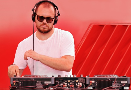 music dj play live on party disco conceprt on red background photo