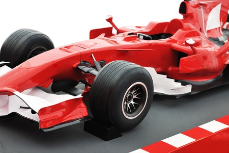 formel 1 one auto fast red  car isolated on white background in studio representing power and speed concept photo